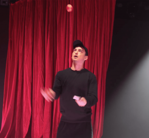 Screen capture from Joji's Extravaganza - Joji is juggling fruit